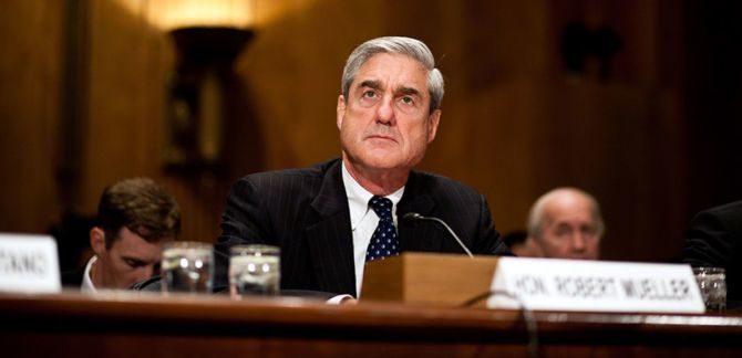 Robert Mueller is seated in a courthouse.