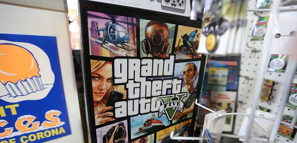 NEW YORK, NY - SEPTEMBER 18: A poster promoting Grand Theft Auto V is displayed at the 8 Bit & Up video games shop in Manhattan's East Village on September 18, 2013 in New York City. (Photo by Mario Tama/Getty Images)