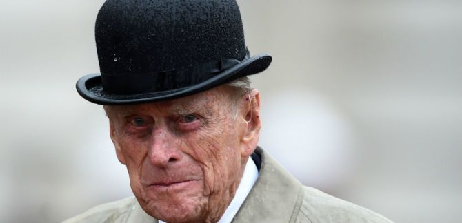 Prince Philip in a hat.