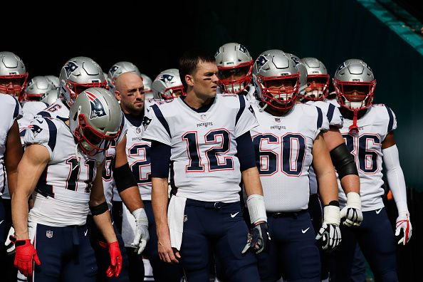 Tom Brady #12 of the New England Patriots and teammates prepare to take the field for their game against the Miami Dolphins