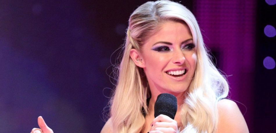 Alexa Bliss talking into a microphone.