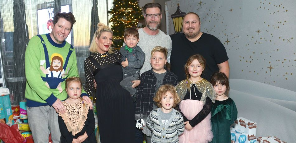 Dean McDermott and Tori Spelling pose with their kids.