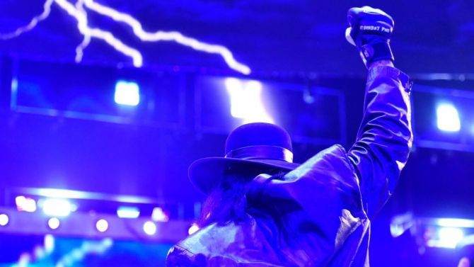 The Undertaker exits a WWE arena