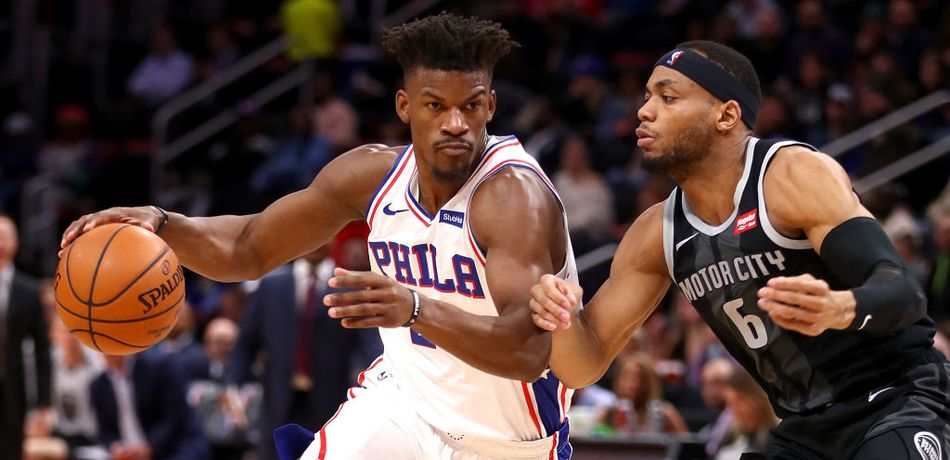 Jimmy Butler #23 of the Philadelphia 76ers drives around Bruce Brown #6 of the Detroit Pistons during the first half at Little Caesars Arena on December 07, 2018 in Detroit, Michigan.