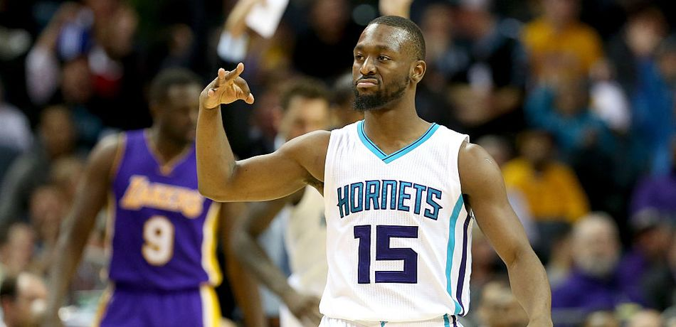 Kemba Walker #15 of the Charlotte Hornets reacts after making a shot against the Los Angeles Lakers during their game at Spectrum Center on December 20, 2016 in Charlotte, North Carolina.