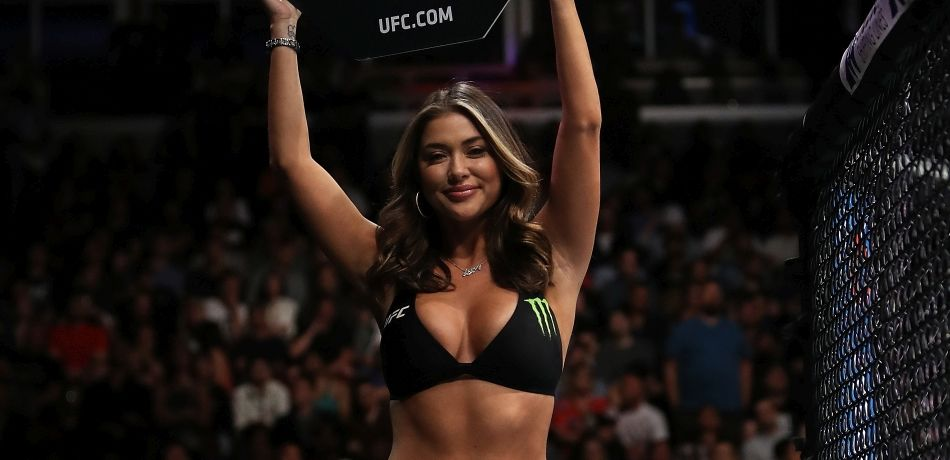 Arianny Celeste holds up a round card at ringside.