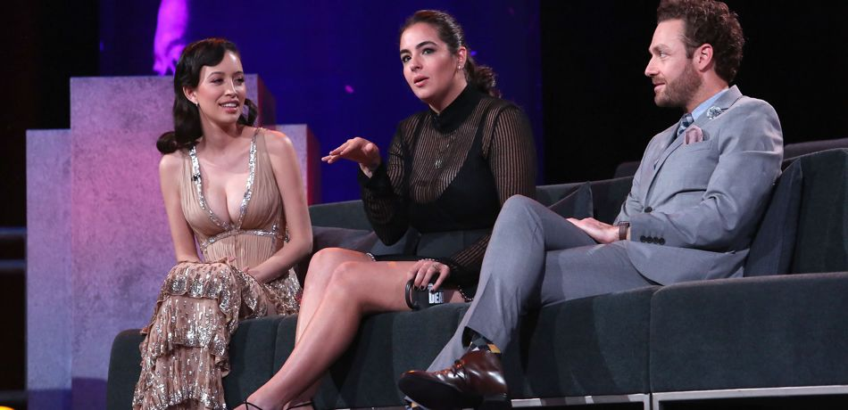 Christian Serratos, Alanna Masterson and Ross Marquand speaking onstage at The Walking Dead 100th Episode Premiere and Party.