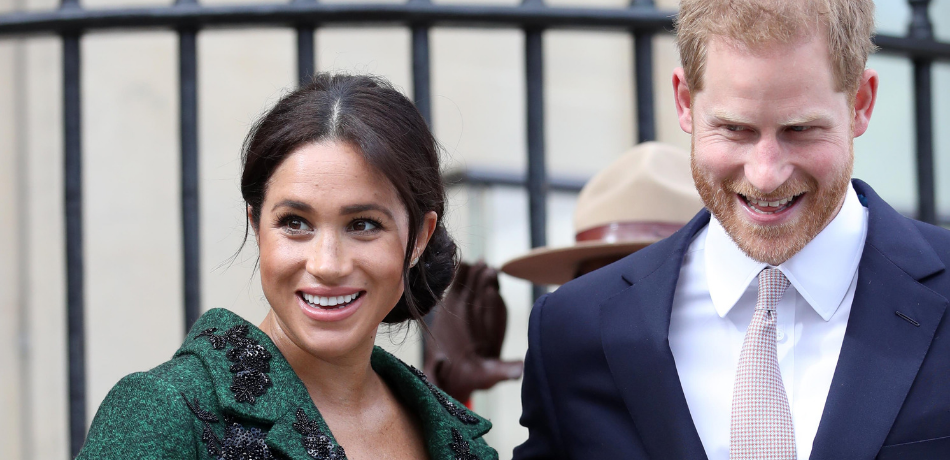 Meghan and Harry walk together.