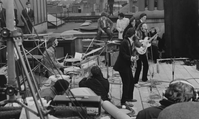 The Beatles perform their last live concert.