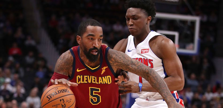 JR Smith #5 of the Cleveland Cavaliers tries to drive around Stanley Johnson #7 of the Detroit Pistons during the first half at Little Caesars Arena on November 19, 2018 in Detroit, Michigan.