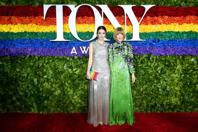 Anna Wintour and daughter Bee Shaffer light up the red carpet in front of the LGBTQ+ flag/wall of flowers