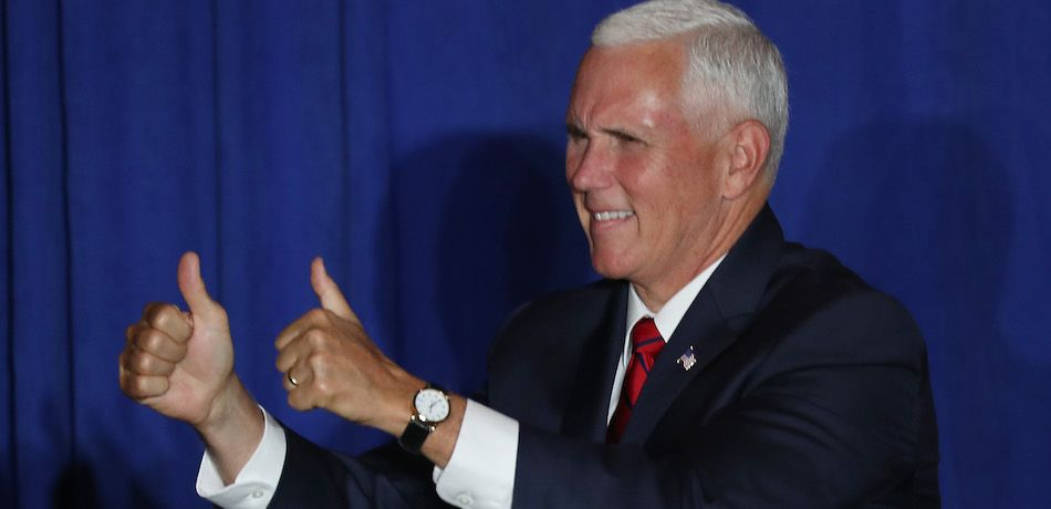 Mike Pence gives two thumbs up.