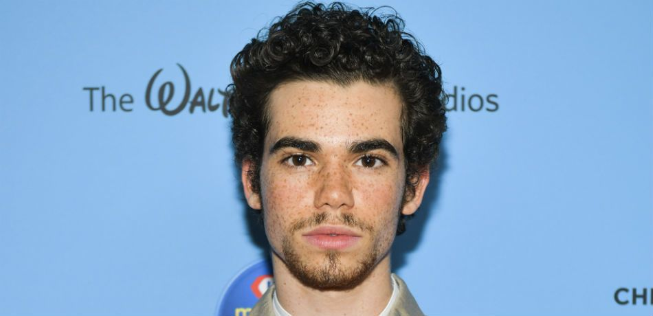 The late Cameron Boyce posing for the camera.