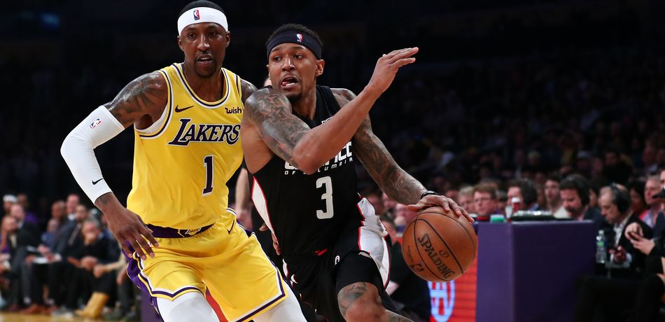 Bradley Beal #3 of the Washington Wizards drives against Kentavious Caldwell-Pope #1 of the Los Angeles Lakers during the first half at Staples Center on March 26, 2019 in Los Angeles, California.