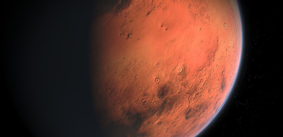 Mars sits in shadow as observed from space.