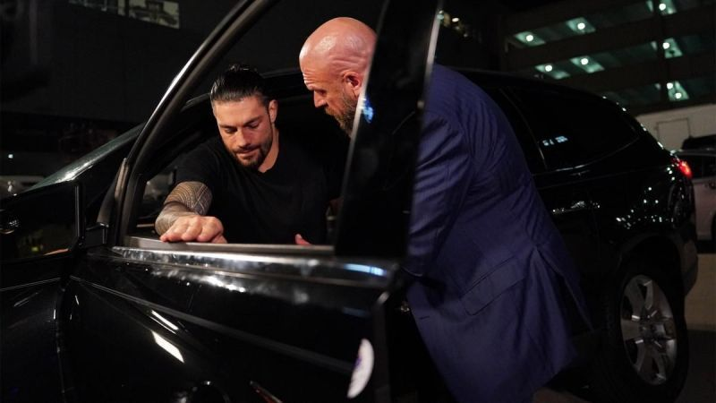 Triple H checks on Roman Reigns after the latest attack.