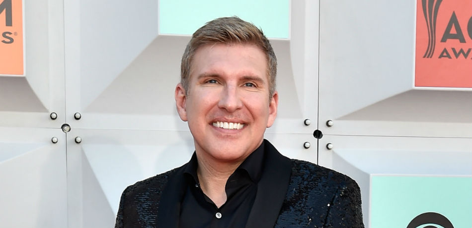 Todd Chrisley poses for a photo at the 'ACM Awards.'
