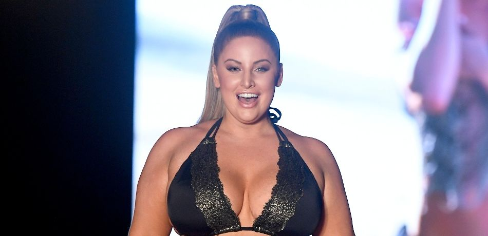 Ashley Alexiss walks the runway during the 2019 Sports Illustrated Swimsuit Runway Show During Miami Swim Week At W South Beach - Runway at WET poolside lounge at W South Beach on July 14, 2019 in Miami Beach, Florida.