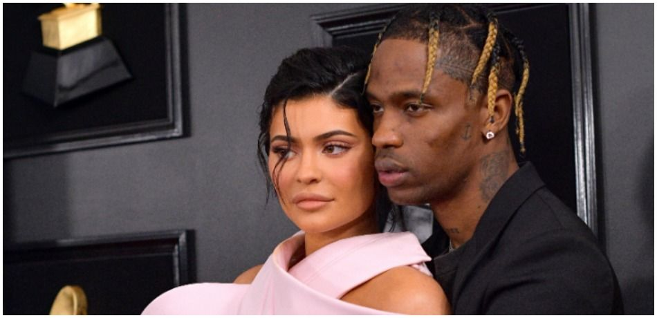 Kylie Jenner and Travis Scott pose on the red carpet.
