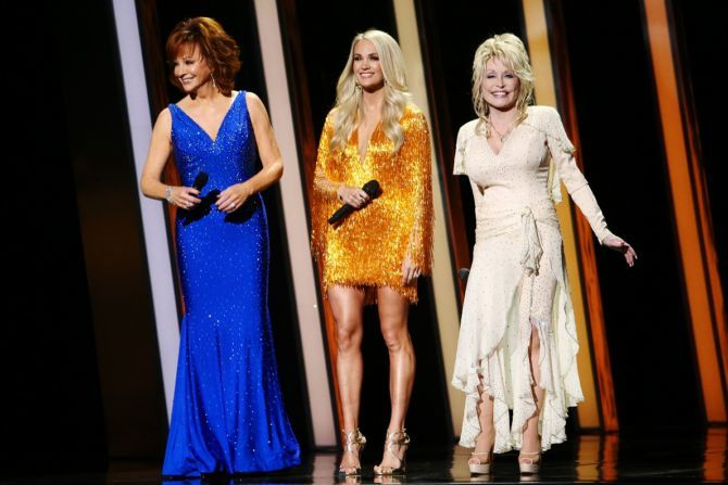Reba McEntire, Carrie Underwood, Dolly Parton perform onstage during the 53rd annual CMA Awards