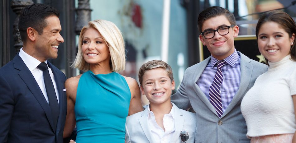 Kelly Ripa and family pose with her star on the Hollywood Walk of Fame.
