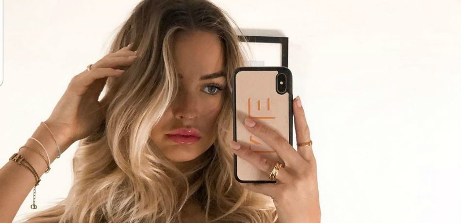 Madi Edwards runs her fingers through her hair while taking a selfie.