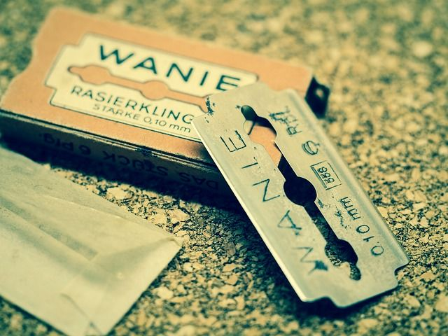 a razor blade removed from its package