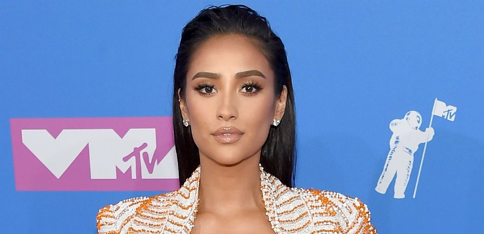 Shay Mitchell poses for a photo on the red carpet.