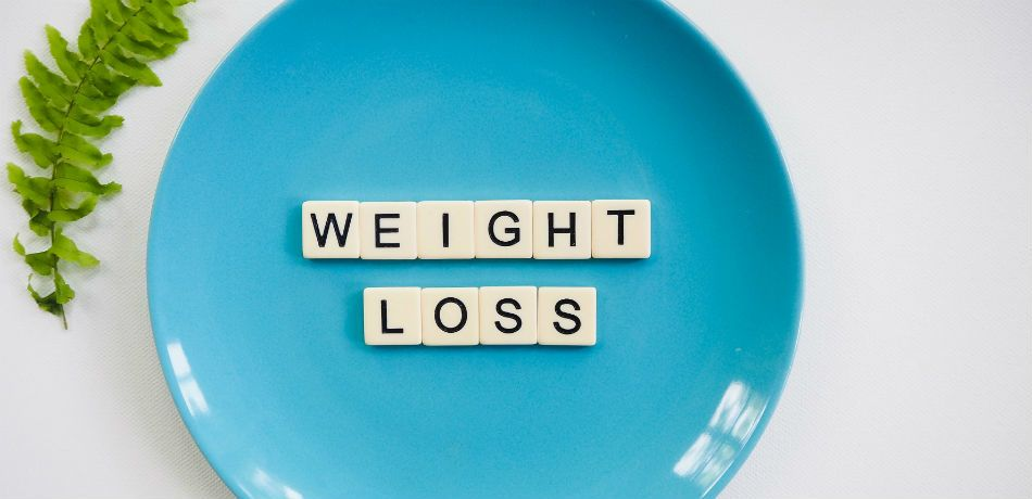 A plate features the words 'weight loss.'