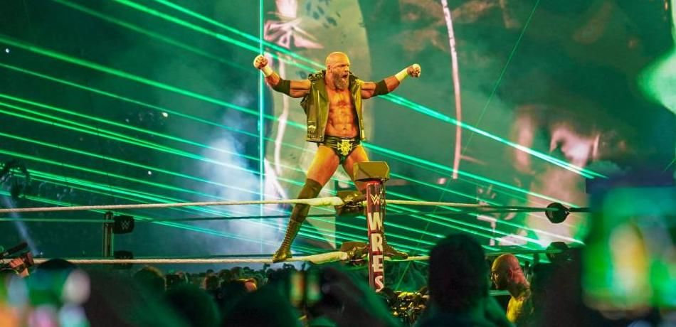 Triple H poses for the crowd.