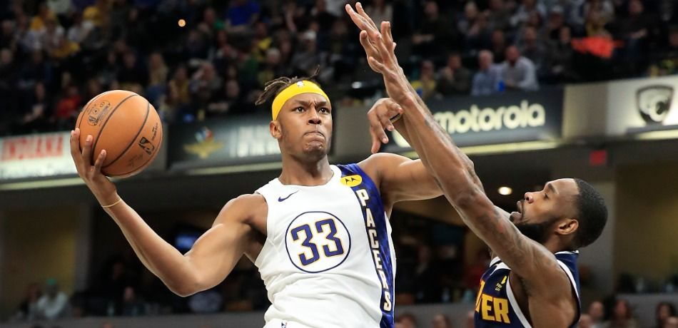 Indiana Pacers center Myles Turner attempts a layup against the Denver Nuggets.