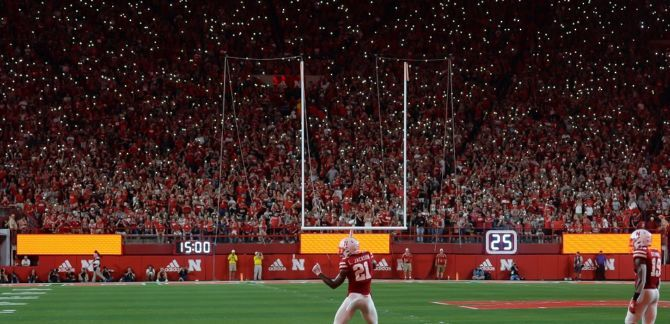 Fans light up the stadium with cell phones during the game between the Nebraska Cornhuskers