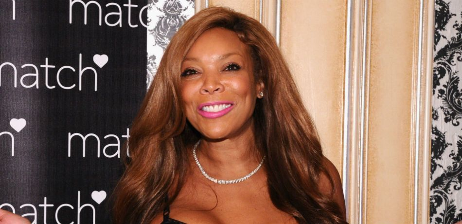 Wendy Williams smiles at the camera.