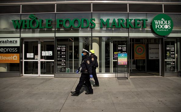 Outdoor signage of a whole foods location