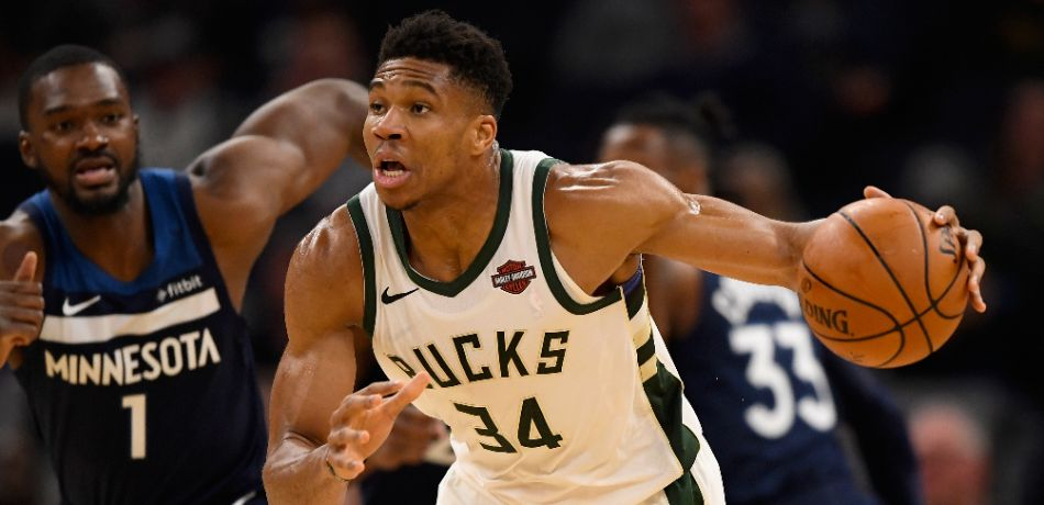 Giannis Antetokounmpo #34 of the Milwaukee Bucks dribbles the ball against the Minnesota Timberwolves during the third quarter of the game at Target Center on November 4, 2019 in Minneapolis, Minnesota.