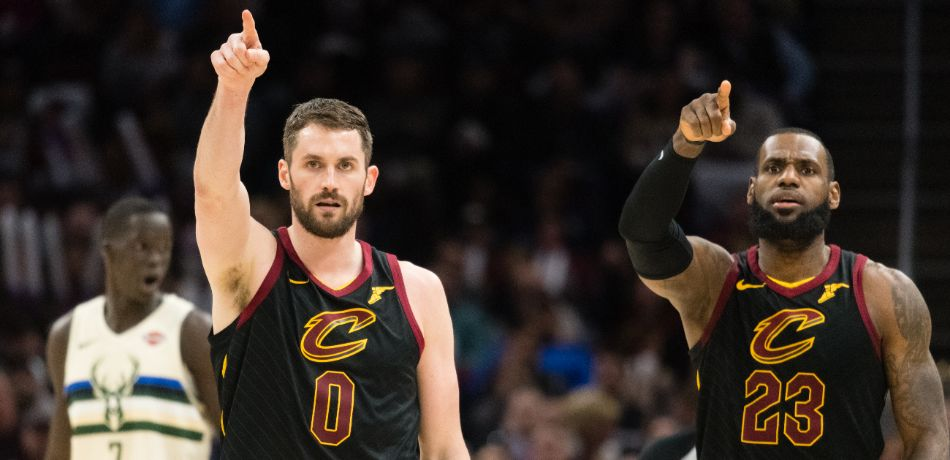 Kevin Love #0 and LeBron James #23 of the Cleveland Cavaliers celebrate after a teammate scored during the second half against the Milwaukee Bucks at Quicken Loans Arena on March 19, 2018 in Cleveland, Ohio. The Cavaliers defeated the Bucks 124-117.
