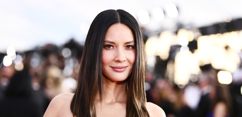 Olivia Munn poses for a photo on the red carpet.
