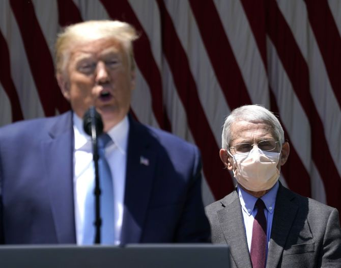 U.S. President Donald Trump is flanked by Dr. Anthony Fauci, director of the National Institute of Allergy and Infectious Diseases while speaking about coronavirus vaccine development in the Rose Garden of the White House on May 15, 2020 in Washington, DC.