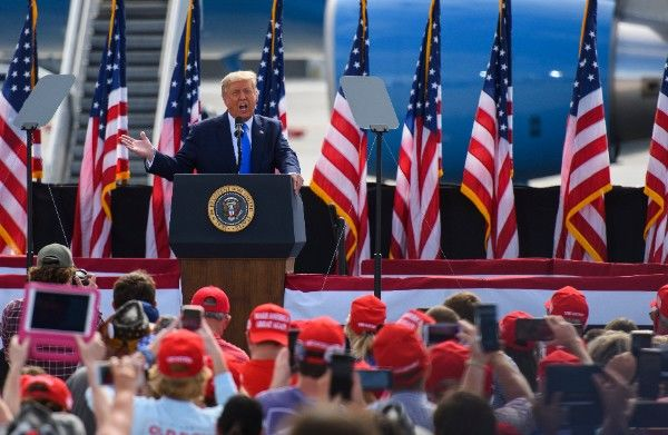 GREENVILLE, NC - OCTOBER 15: President Donald Trump makes remarks during a Make America Great Again rally at the Pitt-Greenville Airport on October 15, 2020 in Greenville, North Carolina. Thousands of people joined to listen to the president 19 days before the 2020 presidential election