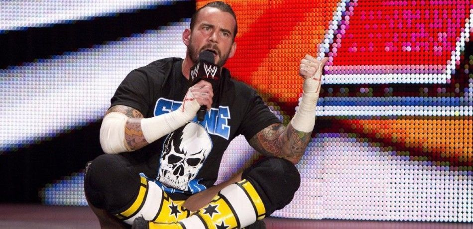 CM Punk cuts a promo on the stage