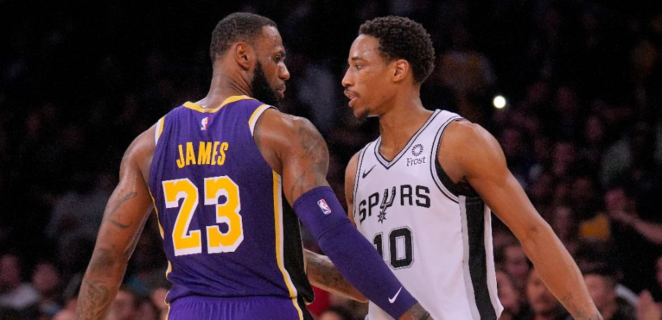 LeBron James #23 of the Los Angeles Lakers and DeMar DeRozan #10 of the San Antonio Spurs shake hands at the end of the game during a 121-113 Laker win at Staples Center on December 5, 2018 in Los Angeles, California.