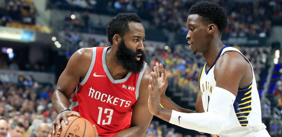 James Harden #13 of the Houston Rockets is defended by Victor Oladipo #4 of the Indiana Pacers at Bankers Life Fieldhouse on November 5, 2018 in Indianapolis, Indiana.